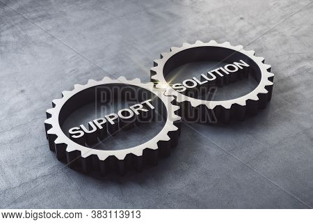 Two Gears Meshing Together With Text Support And Solution On Concrete Table.  Business And Teamwork