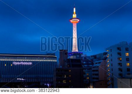 Kyoto, Japan - 14 April, 2019: View Of The Kyoto Tower By Night. The Building, Standing Opposite Kyo