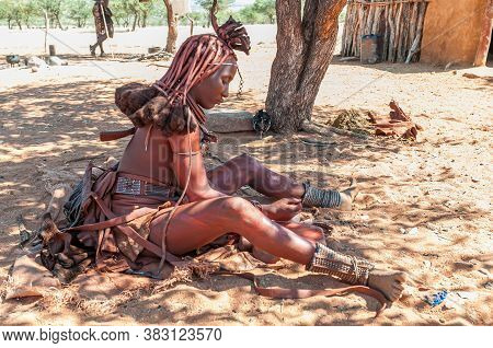 Epupa, Namibia - May 27, 2011: A Married Himba Woman With Traditional Hair Locks And Ornate Headpiec