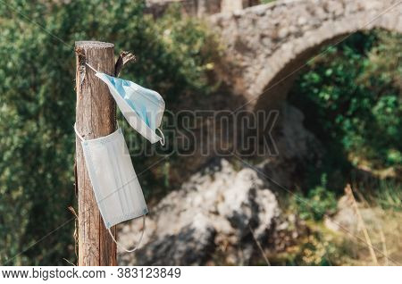Used Surgical Masks Discarded In Nature.  Environmental Pollution