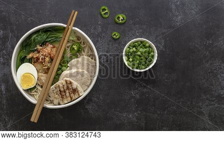 Miso Ramen Asian Noodles With Egg, Chicken, And Pak Choi Cabbage In A Bowl. Japanese Cuisine. Top Vi