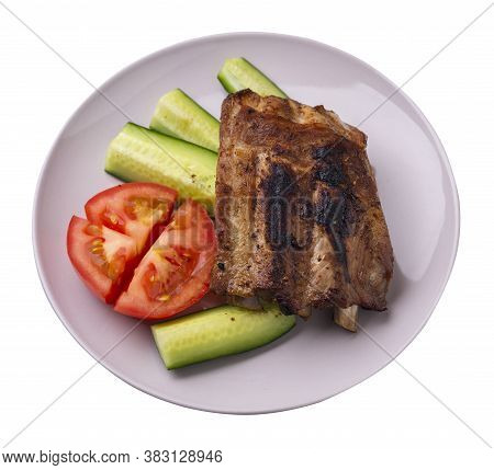 Grilled Pork Ribs With Sliced Cucumbers And Tomatoes On Light Gray Plate. Pork Ribs Isolated On Whit