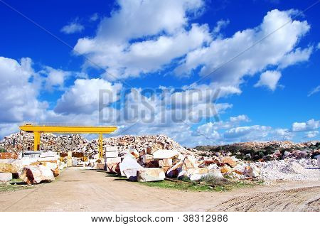 Marble Quarry And Clouds On Blue Sky.