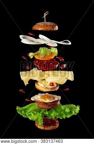 Big Tasty Burger With Meat Cutlet, Cheese, Fried Egg, Tomatoes, Cucumber Pieces And Green Lettuce, F