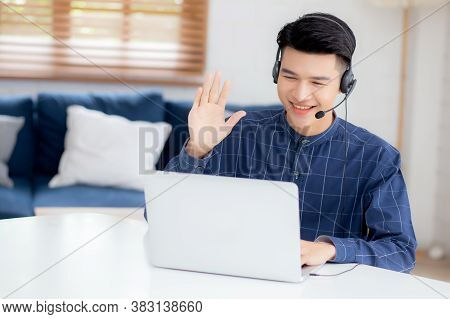 Young Asian Businessman Working On Laptop Computer Wearing Headphone At Home, Business Man Wearing H