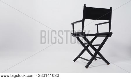 Back Of Black Director Chair Use In Video Production Or Movie And Cinema Industry On White Backgroun