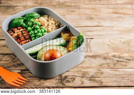 Healthy Lunch In Plastic Containers With Quinoa, Tomatoes, Chicken, Avocado, Cucumber, Green Peas, B