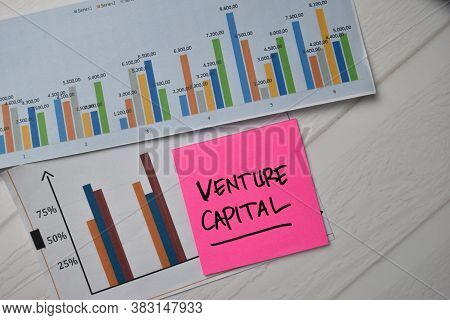 Venture Capital Write On Sticky Notes With Graphic On The Paper Isolated On Office Desk.