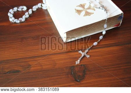Bible And Rosary Beads For A Catholic To Pray  Background With Copy Space  - Stock Photo Image