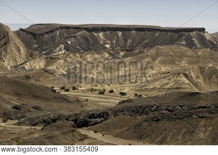 View Of The Ramon Crater Colorful Mountains With Traces Of Geological Events. Negev Desert. Israel