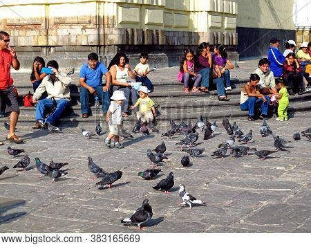 Lima / Peru - 01 May 2011: Some People And Birds Close The Church In Lima, Peru, South America