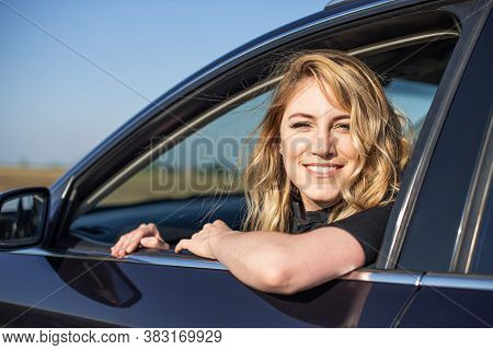 The Blonde In The Car. Attractive Woman Drives A Car.