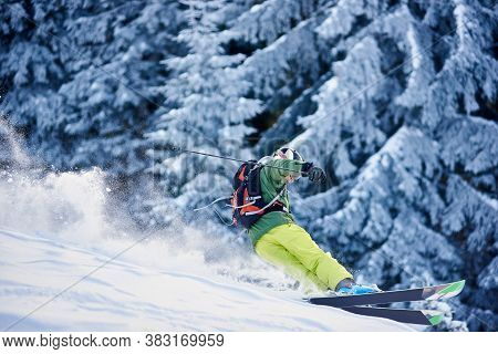 Skier With Backpack Doing Freeride-descent On Snow-covered Slope In White Snow Powder Blizzard. Dang