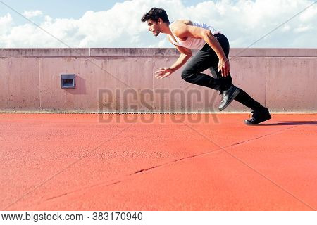 Handsome Male Runner Runs To The Sprint, Concept Of Urban Sport And Healthy Lifestyle, Copy Space Fo