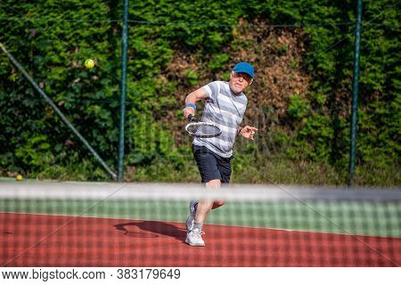 Active Senior Man Playing The Tennis Outdoor, Pensioner Sport Concept, Healthy Lifestyle Senior