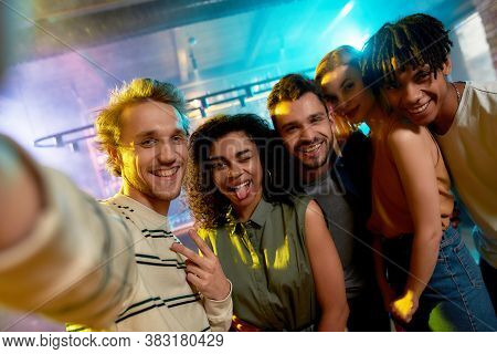 Join Your Friends. Close Up Shot Of Young Men And Women Smiling While Taking Selfie. Multiracial Gro