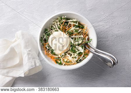 Homemade Healthy Cole Slow Salad With Kale In White Bowl On Gray Textured Background, Top View, Spac