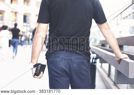 Man With Wallet In Hand, Black Wallet, Brown Wallet