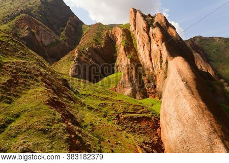 Beautiful Mountains Covered By Fresh Green Grass In Spring Time. At The Top Is The Sky Giving A Fres
