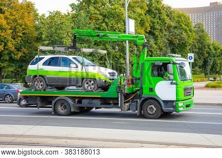 Towing Of Vehicle On Forklift Truck. Tow Truck With Equipped Suspension Mechanism Crane Evacuation A