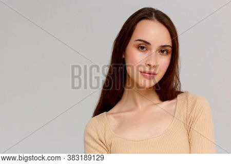 Portrait Of A Young Beautiful Cute Funny Girl Smiling Looking At The Camera On A White Background.