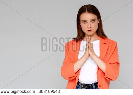 Girl Greets You Buddhist Way. Smiling Attractive Charming Curly-haired Caucasian Woman Holding Palms