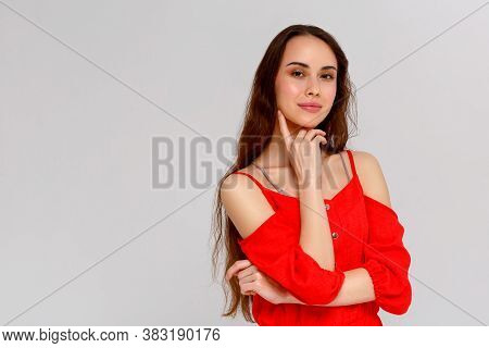 Hmm, Nice Plan. Portrait Of Thoughtful Attractive And Funny Young European Female With Messy Bun In