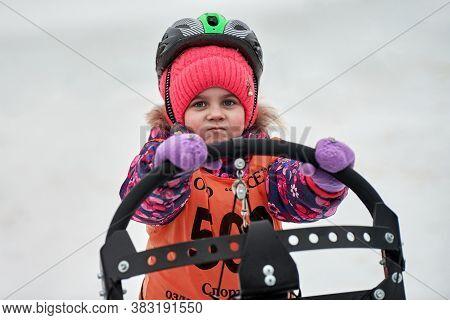 Verkhoshizhemye, Russia - 03.07.2020 - Little Girl On Sled. Kids Junior Sled Dog Racing. Koltco Fort