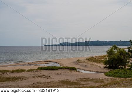 The Beach Of Haväng Is Empty And In The Distance The Mountain And National Park Stenshuvud Is Visibl