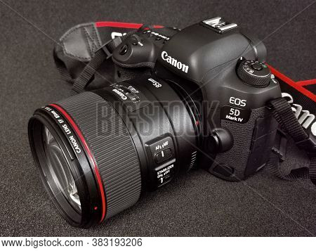 Canon 5d Mark Iv Camera With Canon Ef 85mm F /1.4l Is Usm Lens On A Black Background. 31.08.2020. Wa