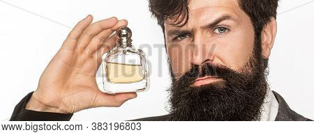 Male Holding Up Bottle Of Perfume. Masculine Perfume, Bearded Man In A Suit. Perfume Or Cologne Bott