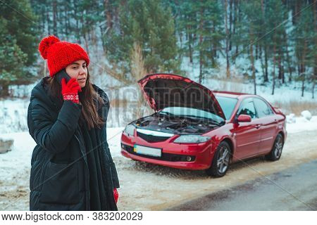Woman Calling For Help With Broken Down Car At Winter Highway