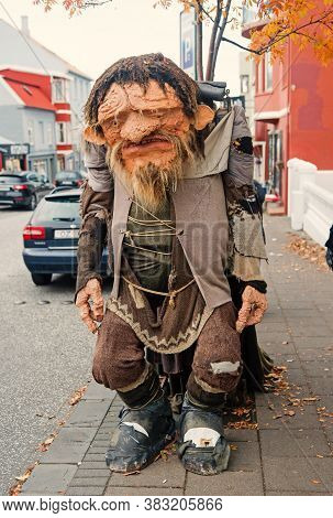 Reykjavik, Iceland - October 12, 2017: Funny Troll Figure On Street. Ugly Troll Figure. Funny And Ug