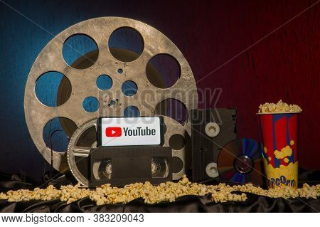 Tula, Russia - August 01,2020: Modern Smartphone With Youtube Logo On Old Film Reels Background