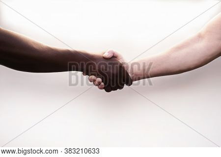 Black And White Hand Hold Each Other, Gesture Of Friendship And Consent. Black And White Man Shake H
