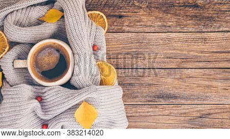 Autumn Or Fall Composition. Fall Leaves, Orange Chips, Hot Steaming Cup Of Coffee And A Cozy Grey Sw