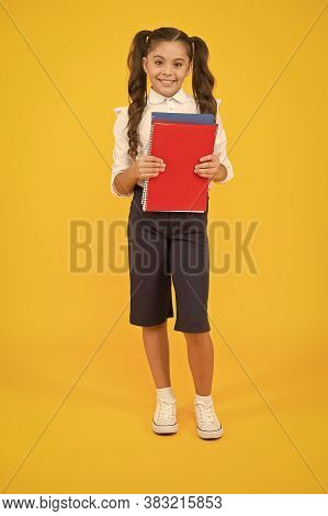 Practise Your Reading Skills. Cute Small Child Holding Reading Books On Yellow Background. Adorable