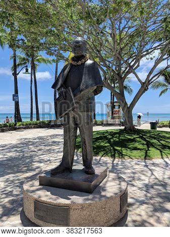 Waikiki - August 20, 2018: Prince Kuhio Statue Covered In Lei's In Waikiki. Jonah Kūhiō Kalanianaʻol