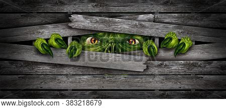 Halloween Monster Background And Creepy Horror Beast Or Zombie Breaking Out Of  A Wood Fence As A Sc