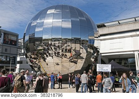 Bristol, Uk - April 22, 2017: The Distorted Reflections Of Partcipants In The March For Science Are