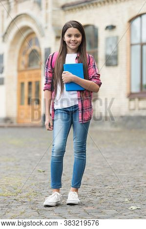 Study To Achieve Great Things. Happy Child Hold Study Book Outdoors. Back To School. Home Study. Hom