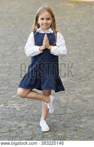 Meditation For Mental Balance. Little Kid In Uniform Meditate Outdoors. Small Child Hold Praying Han