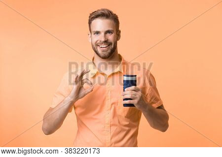 Make Hair Stronger And More Resilient. Man Handsome Bearded Hipster Hold Plastic Bottle Shampoo Or S