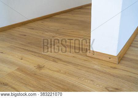 Home Wood Laminate Flooring Background. Light Wooden Textured Interior House Floor.