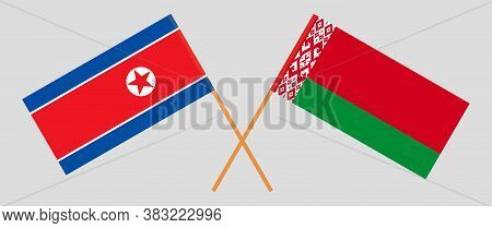 Crossed Flags Of Belarus And North Korea. Official Colors. Correct Proportion. Vector Illustration