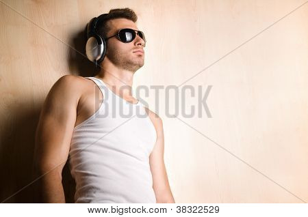 Young male listening music