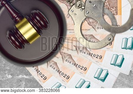 200 Czech Korun Bills And Judge Hammer With Police Handcuffs On Court Desk. Concept Of Judicial Tria