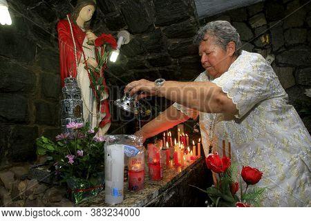 Salvador, Bahia / Brazil - December 3, 2013: Devotee Of Santa Barbara Makes Preparations For A Party