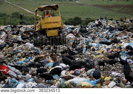 Porto Seguro, Bahia / Brazil - May14, 2008: Tractor Is Seen Turning Trash In The Sanitary Landfill O