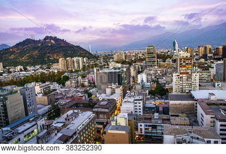 Santiago de Chile dwontown after sunset with Andes mountains in the back, Chile